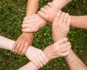 Hands interlocked together